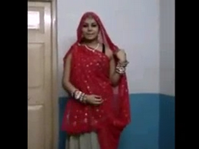 Dp fhg 943. Rajhastani wife dancing in ghagra cholie filmed by